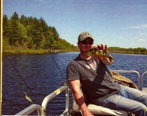 This isn't me, and the shot has no business being in this blog, but for hte fact that this guy's holding a perch, a fish rarely seen on our lake in the past twenty years.....