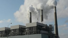 coal-power-plant-emitting-carbon-dioxide-smokestacks-three-fired-emit-pollution-60081810